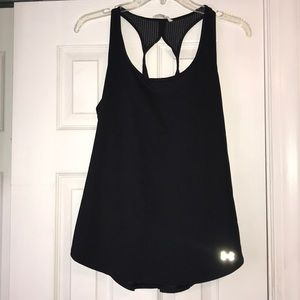 Under Armour black fitted tank top.
